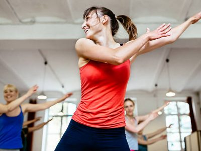 Female trainer with her aerobics class in a gym